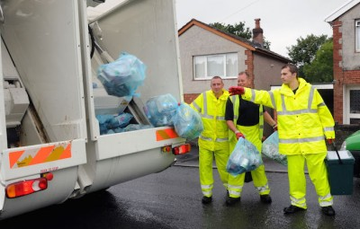 binmen collecting rubbish for Carmarthenshire County Council