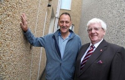 Leader of Neath Port Talbot Council Cllr Ali Thomas pictured with Mr. Watts outside his home in Beverley Street, Port Talbot